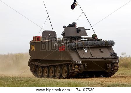 WESTERNHANGER, UK - JULY 24: An ex US army M113 APC gives a demonstration to the public in the main arena at the War & Peace show on July 24, 2015 in Westernhanger