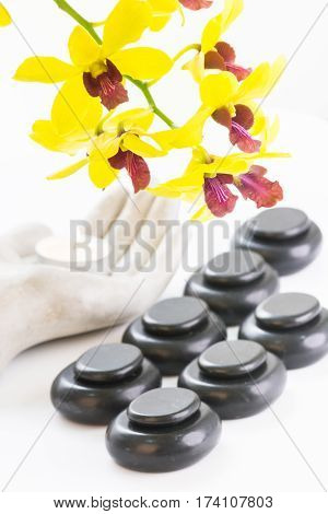 Spa concept with basalt stones and tea light