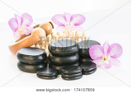 Spa therapy with zen stones, massage roller and cellulite massager