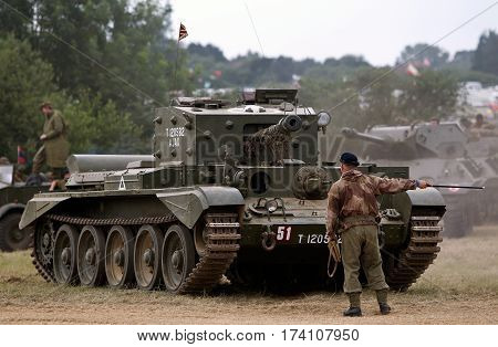 WESTERNHANGER, UK - JULY 24: A WW2 Comet tank is guided into its parking place before participating in a battle re-enactment at the War & Peace show on July 24, 2015 in Westernhanger