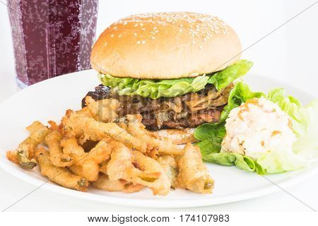 Grilled Chicken Burger with caramelized onions served with jalapeno fries and coleslaw