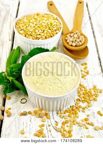 Flour Pea And Split Pease In Bowls And Spoons On Light Board
