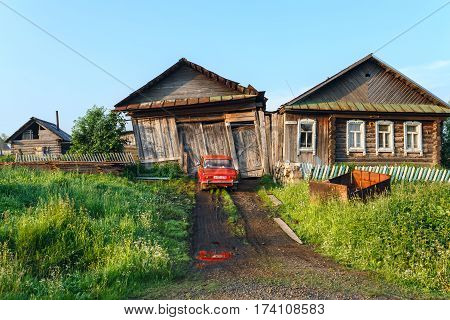 VISIM/ RUSSIA - JUNE 22, 2015. Ramshackle country house with garage and bath. Old believer village Visim, Sverdlovsk oblast, Russia.