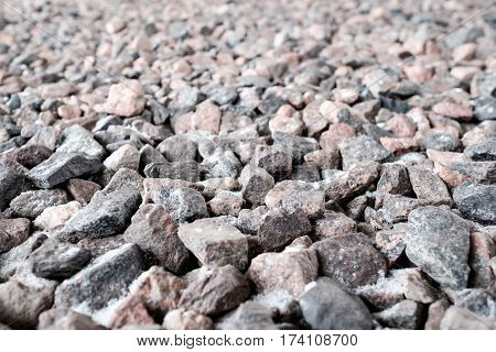Crushed stone abstract textured background. Selective focus