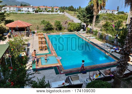 Camyuva Kemer Antalya Turkey - 29 august 2014: The guests of a small hotel relax by the outdoor swimming pool.