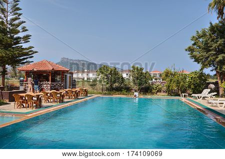 Camyuva Kemer Antalya Turkey - 29 august 2014: Swimming pool barbecue area with bar in small hotel.