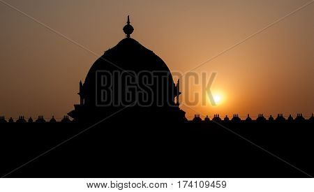 NEW DELHI, INDIA: Sunset over the silhouettes of the Temple. Chattarpur Mandir, South-Western suburb of new Delhi, India.