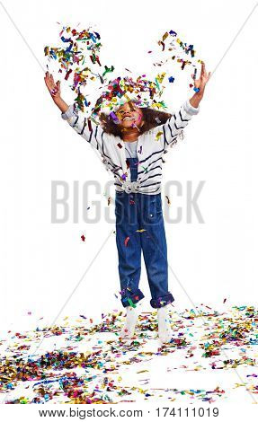 Studio portrait of little African girl with big curly hair jumping up with joy tossing huge pile of sparkles in the air and laughing