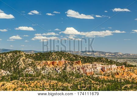 Bryce Canyon National Park a sprawling reserve in southern Utah is known for crimson-colored hoodoos which are spire-shaped rock formations.