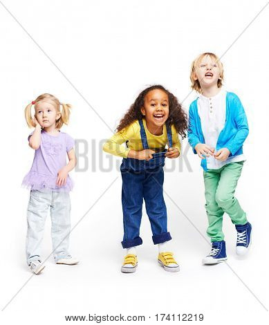 Isolated shapes of three children against white background: cute little blond girl, energetic African girl and screaming boy