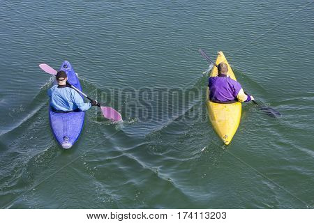 Two rowers with canoe recreate in a lake