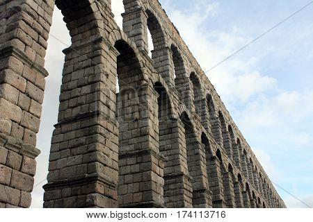 Ancient roman aqueduct in Segovia, Spain. Water Transportation.