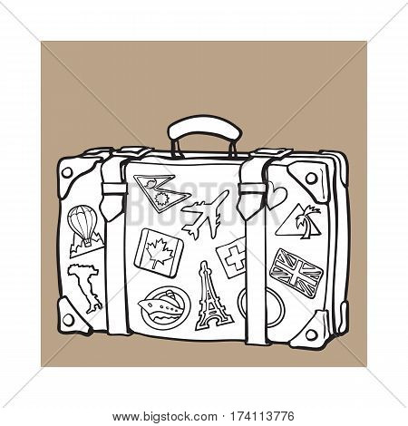 Hand drawn retro style travel suitcase with labels, black and white sketch vector illustration isolated on on brown background. background. Realistic hand drawing of old fashioned suitcase