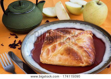 bun with apple tea on an orange background