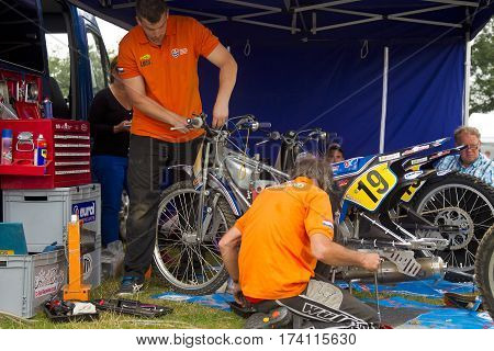 SWINGFIELD, UK - AUGUST 18: Dutch motorcycle mechanics prepare the teams motorcycles for the next heat during the Longtrack World Championships on August 18, 2013 in Swingfield