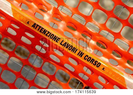 Plastic Orange Safety Net To Delimit The Area Of A Construction