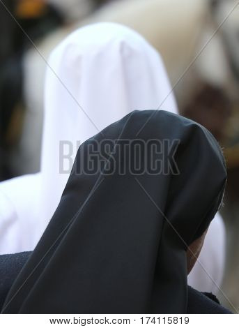 Sisters With Black And White Veil During The Holy Mass At Church