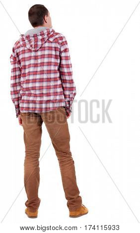 Back view of guy in a plaid shirt with hood  looking. Standing young guy in jeans and  jacket. Rear view people collection.  backside view of person.  Isolated over white background.