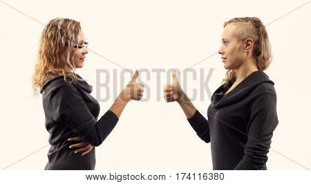 Part of series. Self talk concept. Young blond caucasian woman talking to herself showing gestures. Double portrait from two different side views.
