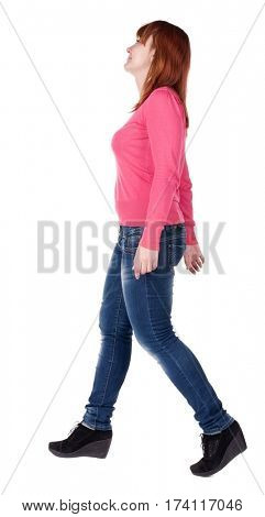 back view of going brunette girl in red. beautiful woman in motion.  side view of person. Isolated over white background.