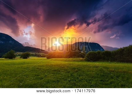 Wonderful view of green fields with hills in the sunlight. Location place Triglav national park, Bohinj valley, Julian Alps, Slovenia, Europe. Dramatic and unusual scene. Discover the world of beauty.