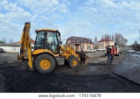 Countryside near Kiev. Bad road reparing..March 1,2017,Kiev, Ukrai