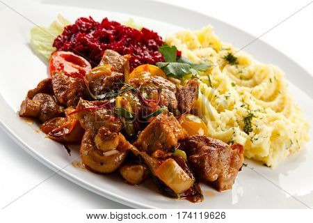 Goulash with baked potatoes and vegetables