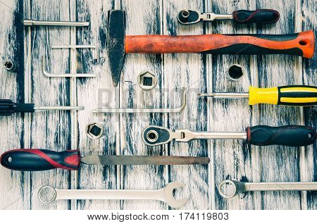 Tools on wooden table. Tools for DIY on a black and white wooden background.