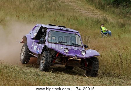 WULSTAN, UK - JULY 21: An unnamed driver speeds over open ground towards a wooded section of the course during the AWDC UK Brit Part Comp Safari competition on July 21, 2013 in Wulstan.