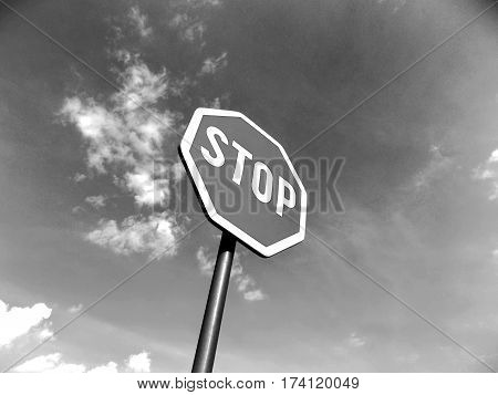 Stop roadsign on the road and sky