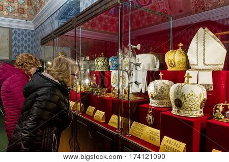 Uzhgorod Ukraine - February 23 2017: Visitors look at exhibits of the exhibition Crowns of the World during its opening.