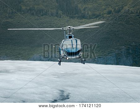 Single-engine helicopter landing on an ice field