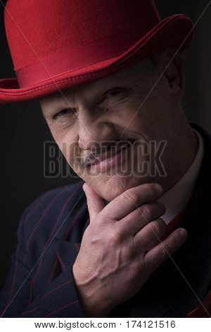 Portrait of a mature gangster on a black background