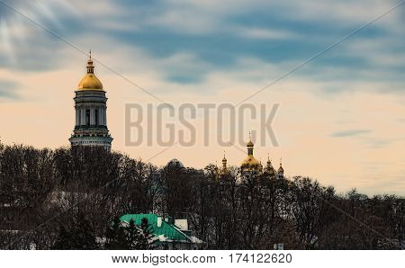 Monastery Kiev-Pechersk Lavra with golden domes sitting atop its fleet of victory in Kiev soft focus