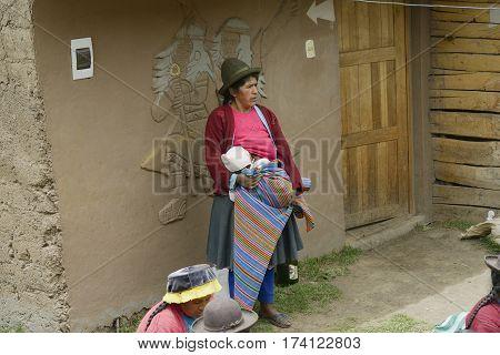 Native peruvian woman and her baby, Paru Paru Community, Andes Mountain. October 22 2012 - Paru Paru Peru