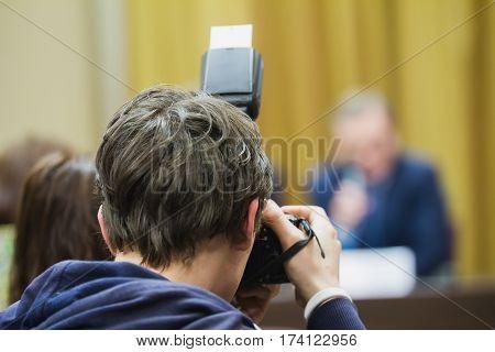 Photographer at press conference - telephoto close up, horizontal