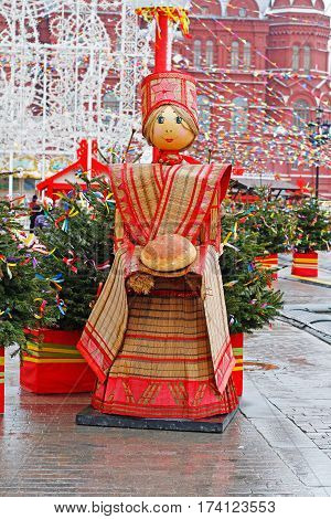 Moscow Russia - February 21 2017: Russian Shrovetide statue in traditional colorful dress with a loaf at Russian national festival