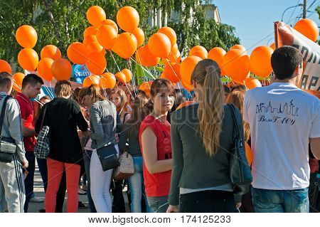 Volgograd Russia - May 01 2012: Students with orange balloons take part in the May day demonstration in Volgograd