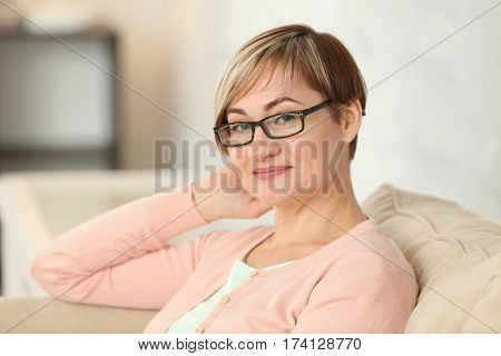 Portrait of mature woman wearing glasses at home