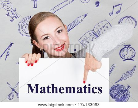 Young woman holding whiteboard with writing word: mathematics. Technology, internet, business and marketing