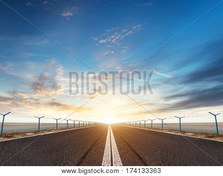 airport runway or road in the evening sunset light, ready for airplane landing or taking off