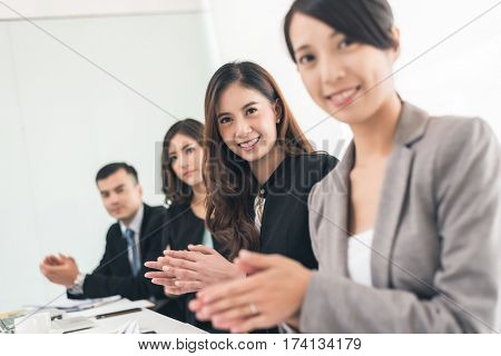 asian business group applaud in the office