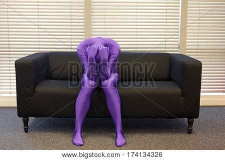 depressed  - anonymous, crooked,loneliness,man sitting on sofa in office,