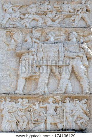 TIRANA, ALBANIA - SEPTEMBER 27: Relief above the Council of Ministers glorifies socialist victory in all fields, Tirana, Albania on September 27, 2016.