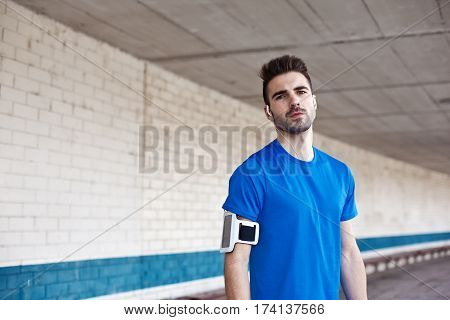 portrait of young athlete with stubble outdoors