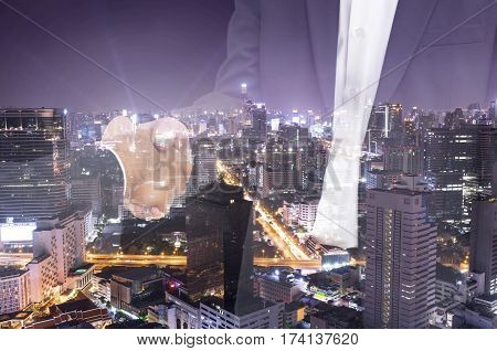 double exposure of businessman shakehand and cityscape for commitment - can use to display or montage on product