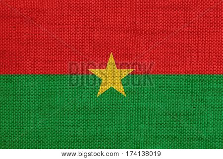 Colorful and crisp image of flag of Burkina Faso on old linen