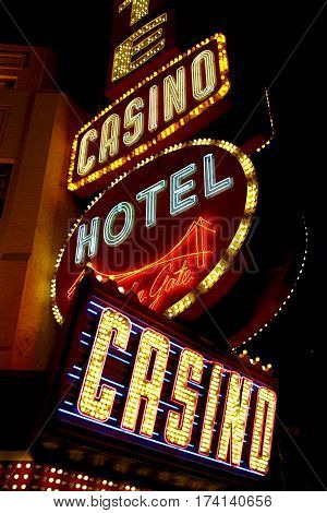 LAS VEGAS - OCTOBER 10, 2016: Golden Gate Hotel & Casino sign illuminated by night, on October 10, 2016 in Las Vegas. It is the oldest and smallest hotel located on the Fremont Street Experience.