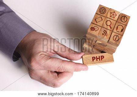 Business, Technology, Internet And Network Concept. Young Businessman Shows The Word: Php