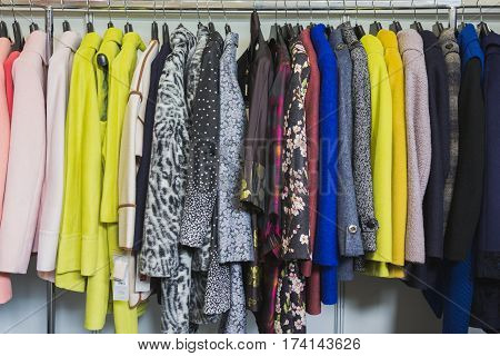 Colourful clothes in clothing store - dresses and jackets, horizontal